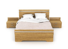 Wooden bed with linens. Two bedside tables about bed Royalty Free Stock Photo