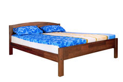 Wooden bed with mattress Royalty Free Stock Photo