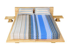 Wooden bed with mattress Royalty Free Stock Images