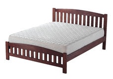 Wooden bed with mattress Stock Photos
