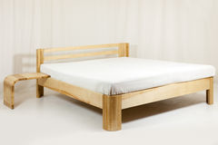 Wooden bed Royalty Free Stock Image