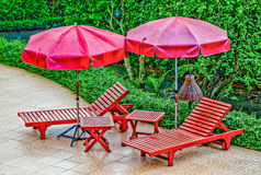 Wooden bed with umbrella Royalty Free Stock Photo