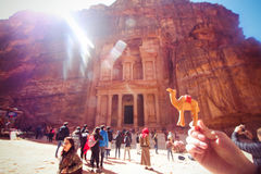 Wooden bedouin camel in hand near the treasury Al Khazneh carved into the rock at Petra, Jordan Stock Image