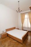 Wooden bedroom Stock Images