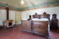 Wooden bedroom in ancient italian house with floral fresco Stock Photography