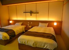 Wooden bedroom of a luxury hotel royalty free stock photos