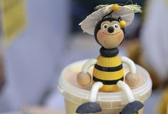 Wooden bee figurine in a honey store.  royalty free stock photo