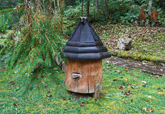 Wooden beehive and falling leaves. On a rainy day royalty free stock images