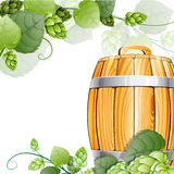 Wooden beer barrel  and hops on white Royalty Free Stock Photos