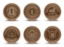 Wooden beer emblems mats icons set Stock Image