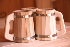 Wooden beer mugs. Three wooden beer mugs on table Royalty Free Stock Photo