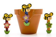 Wooden bees with flowerpot Stock Image