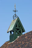 Wooden belfry with wind vane and compass card Stock Images