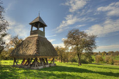Wooden bell tower wit thatch. Old wooden bell tower wit thatch in Hungary stock image