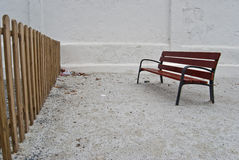 Wooden bench. Behind a fence Royalty Free Stock Photo