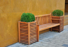 Wooden bench. In front of the building Royalty Free Stock Images