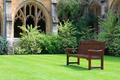Wooden bench. In quiet garden stock images