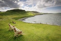 Wooden bench. With a stunning view - Isle of Skye, Scotland Royalty Free Stock Photo