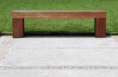 Wooden Bench. Plain Simple Wooden Bench On Footpath In A Park royalty free stock photo