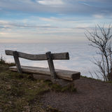Wooden bench above inversion fog in black forest Royalty Free Stock Images