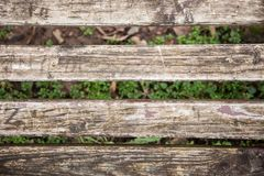 Wooden bench abstract grunge background,Focus long wooden benches no one sitting but have a leaf fall around with vintage. Background royalty free stock photos