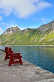 Wooden bench against the Norwegian fjord. Norwegian fjord. Wide-angle photo Stock Photography