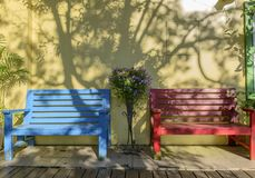 Wooden bench against a white wall Royalty Free Stock Image