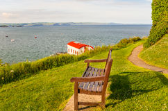 Wooden Bench along a Coastal Path Stock Images
