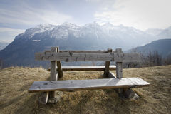 Wooden bench on the alps Royalty Free Stock Photo