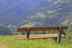 Wooden bench. In the austrian alps Stock Photography
