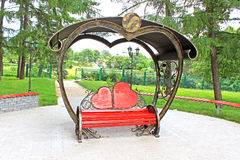Wooden bench with back in the form of hearts Royalty Free Stock Image