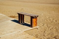 Wooden bench on the beach. Close view Royalty Free Stock Photos