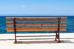 Wooden bench on the beach Royalty Free Stock Photos