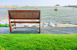 Wooden bench on the beach for relaxation Royalty Free Stock Photos