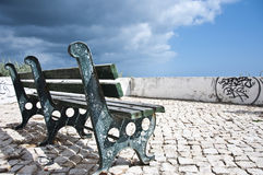 Wooden bench. With blue sky full of clouds Royalty Free Stock Images