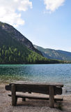 Wooden bench on the Braies lake Royalty Free Stock Photography