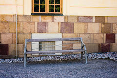 Wooden bench and brick wall Stock Photos