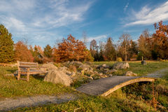 Wooden bench and bridge. Autumn landscape with wooden bench and bridge Stock Photos