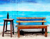 Wooden bench and chair Royalty Free Stock Photography