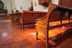 Wooden bench in church Stock Photos