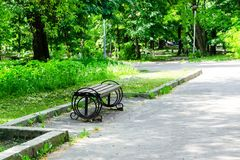 Wooden bench in the city park stock photography