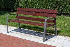 Wooden bench in the city park. Royalty Free Stock Photo