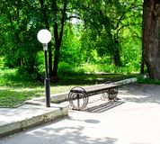 Wooden bench in the city park royalty free stock photo