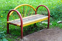 Wooden bench in the city park Stock Images