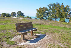 Wooden bench. A wooden bench close to the ocean, at Bellair Beach, FL Royalty Free Stock Photography