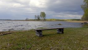 Wooden bench on coast of lake. Braslav. Belarus. Panoramic view stock video