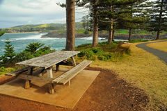 Wooden bench on a coastal hill Royalty Free Stock Images