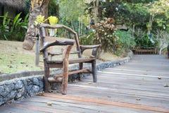 Wooden bench in the corridor. The corridor is a wooden walkway walking in the garden Royalty Free Stock Images