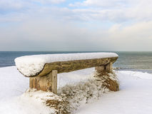 Wooden bench covered with snow Royalty Free Stock Image