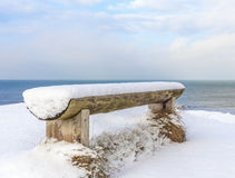 Wooden bench covered with snow Royalty Free Stock Photos